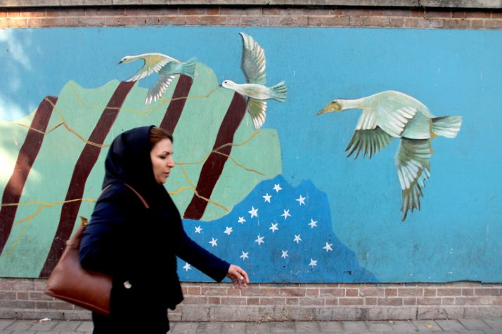 "An Iranian woman walks past a mural on the wall of the former US embassy in the Iranian capital Tehran on November 9, 2016. Iran's President Hassan Rouhani said there was ""no possibility"" of its nuclear deal with world powers being overturned by US president-elect Donald Trump despite his threat to rip it up.   / AFP / ATTA KENARE        (Photo credit should read ATTA KENARE/AFP/Getty Images)"